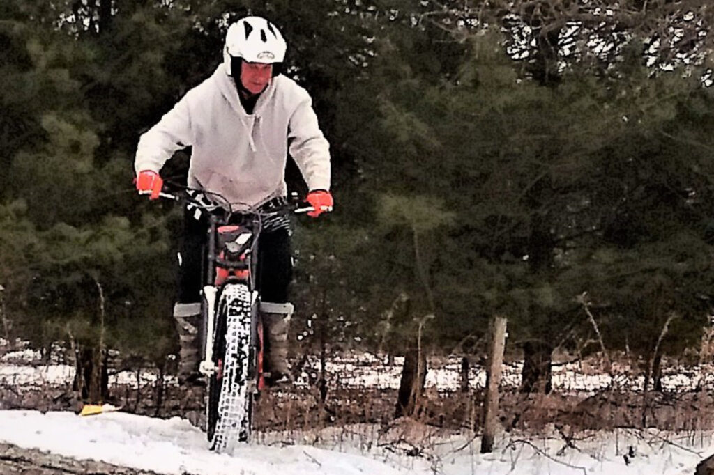 Mike riding in snow.